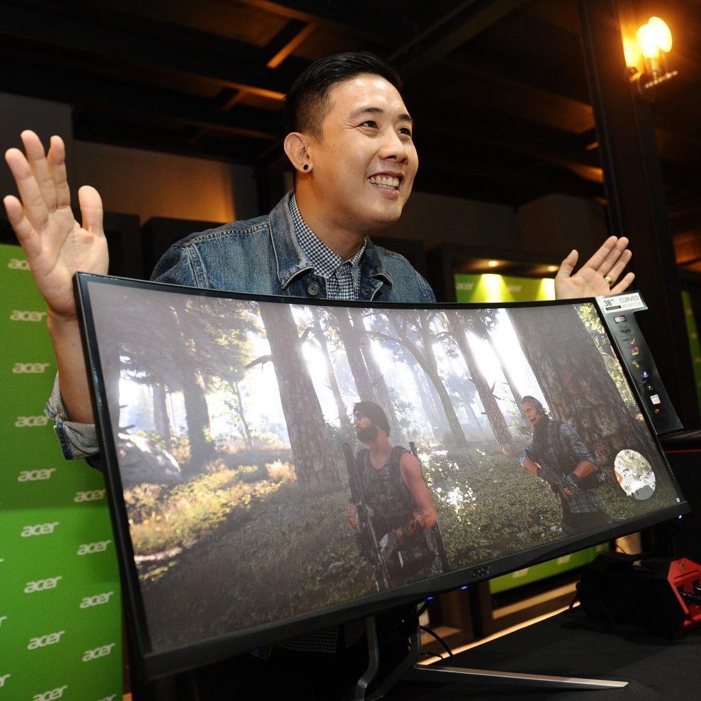 Acer Malaysia Product Manager Edmund Hoh with the newly launched Acer's first monitor that features an UltraWide QHD+ in a zero-frame display - XR382CQK monitor