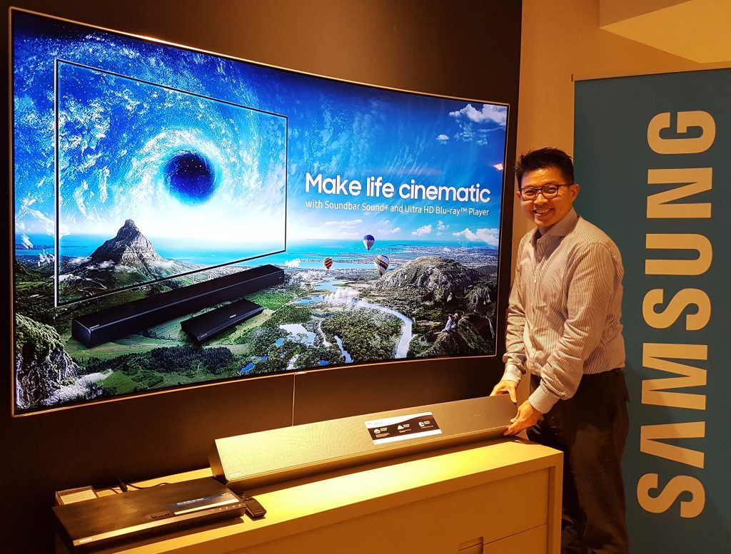 Jason Foo, Head of Audio Visual of Samsung Malaysia Electronic, proudly presents Samsung Soundbar (HW-MS751) alongside the QLEDTV and 4K Ultra HD Blu-ray Player.