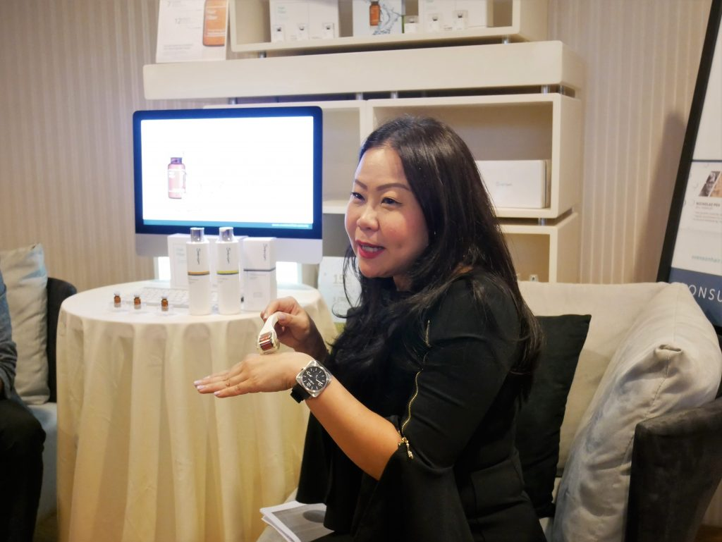 Kim Fong, Group Trichologist of Svenson explaining about how hair fillers work.