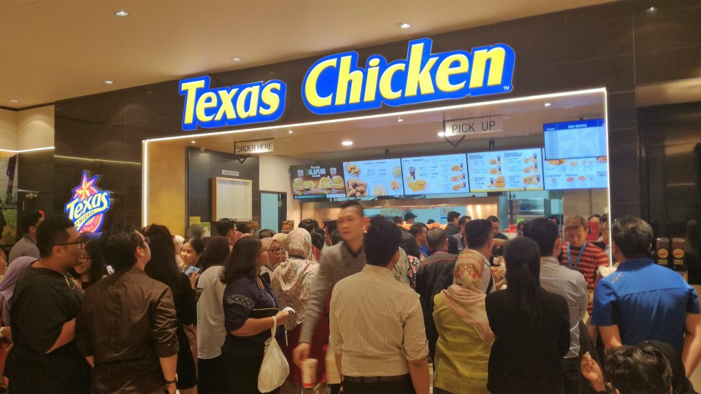 People crowding to get their hands on the delicious, Texas Chicken