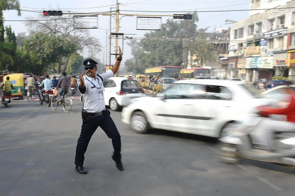 Moonwalking Indian Cop Keeps Traffic Entertaining