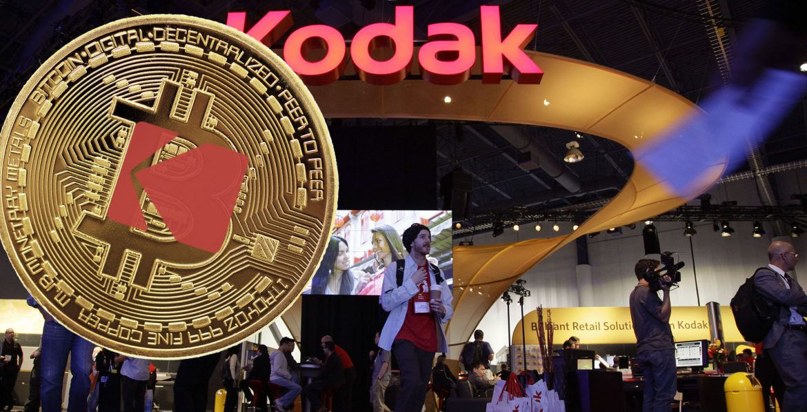 Buyers and industry affiliates pass by the Kodak exhibit at the 2012 International CES tradeshow, Wednesday, Jan. 11, 2012, in Las Vegas.  Eastman Kodak filed patent lawsuits against HTC Corp. and Apple this week. (AP Photo/Julie Jacobson)