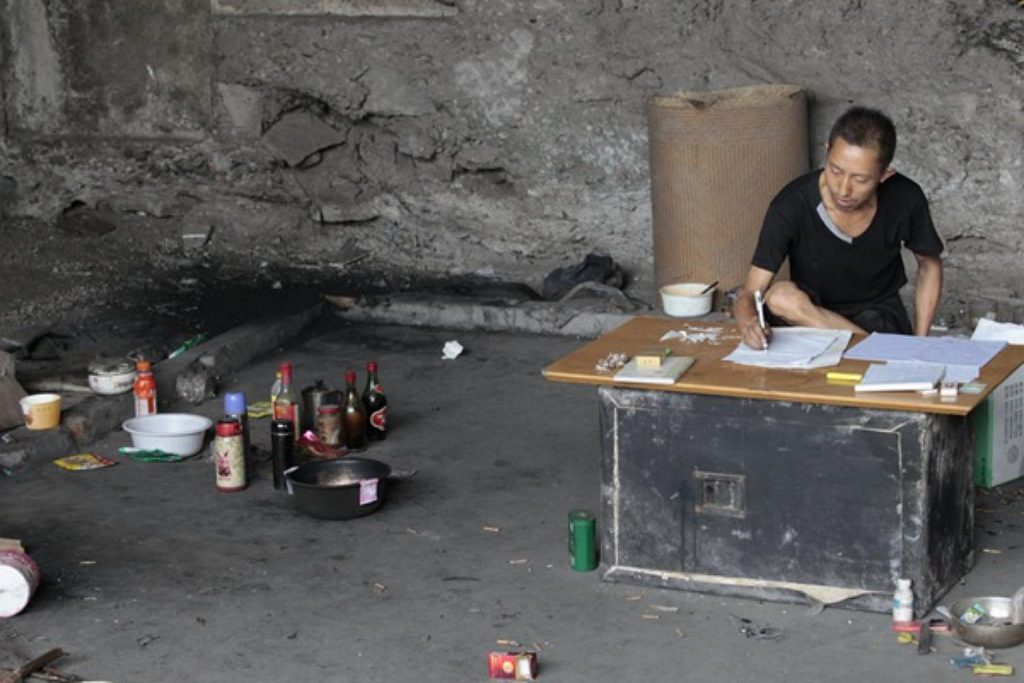 "Chinese Man Spend 10 Years Being Homeless to ""Crack Lottery Code"""