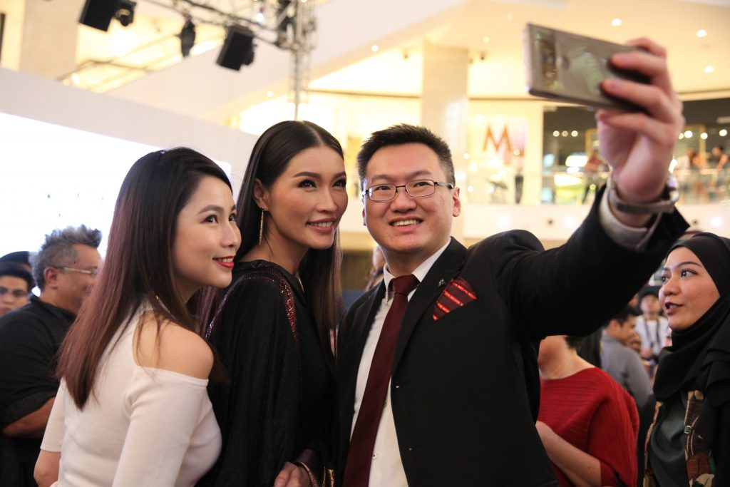 Amber Chia (middle) is all smiles for the camera