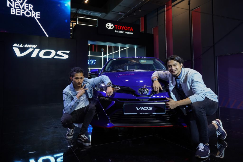 Stars of As Never Before Shukri Yahaya and Shawn Lee posing for a photo with the all-new Toyota Vios.