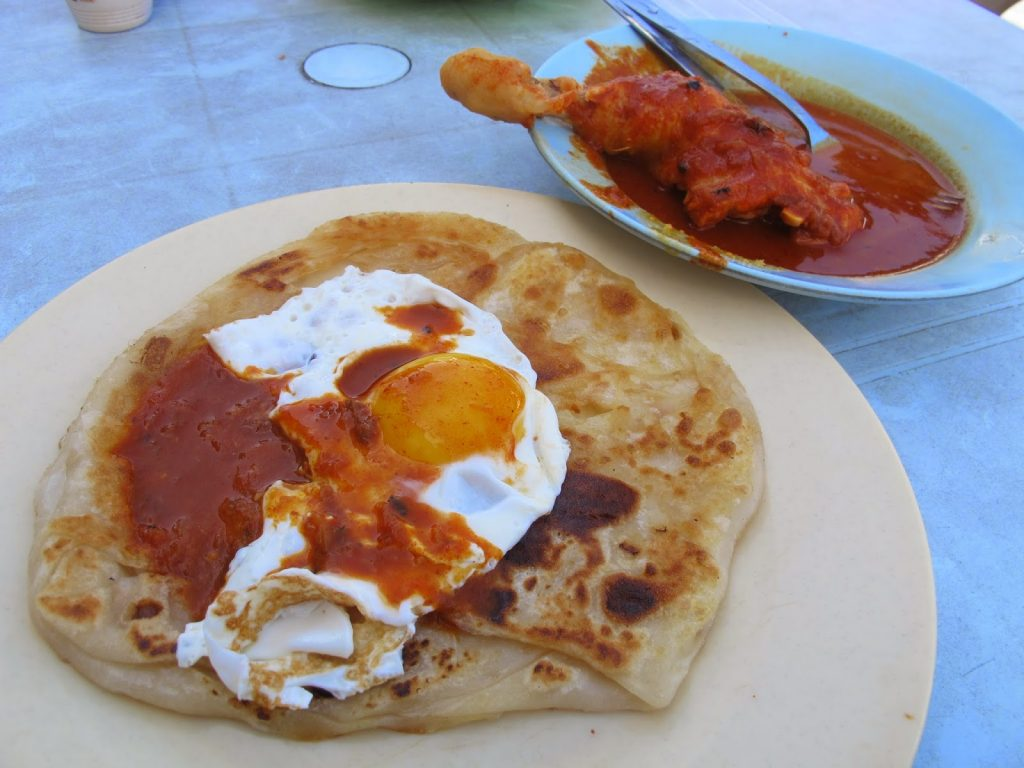 Fill your tummy up with breakfast from the famous Roti Canai Transfer Road (image via Michelle Nomms)