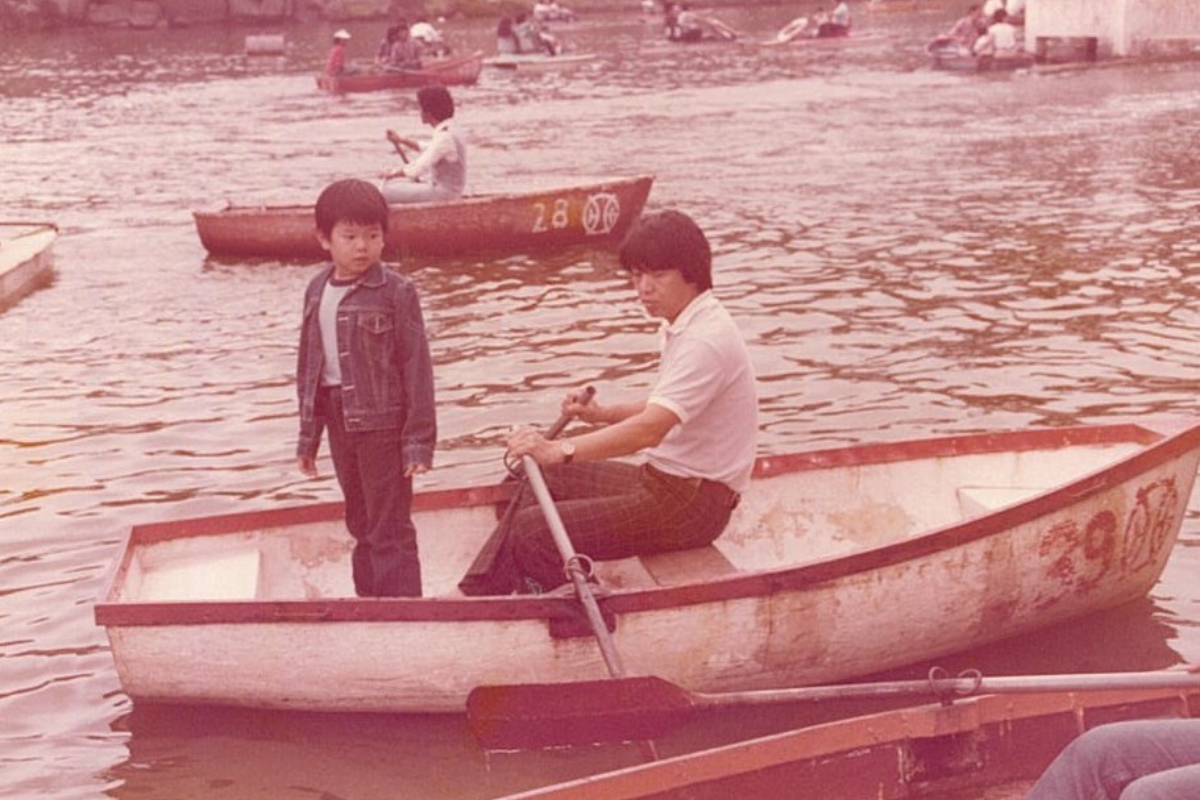 Jeremy and his father enjoying a day out on the lake, soaking in the serenity.
