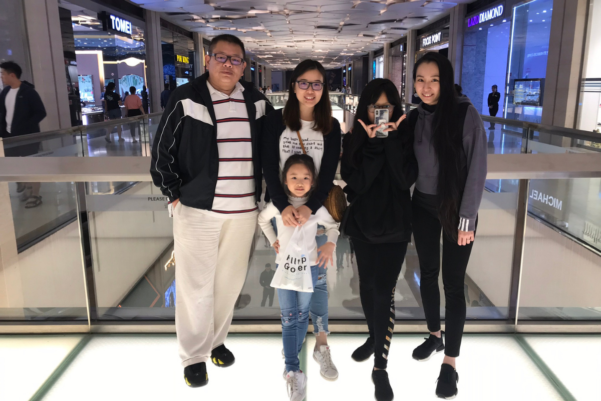 Jeremy (left), along with his wife, Ivy (2nd from left) and family having a day out at SkyAvenue Complex, Resorts World Genting.