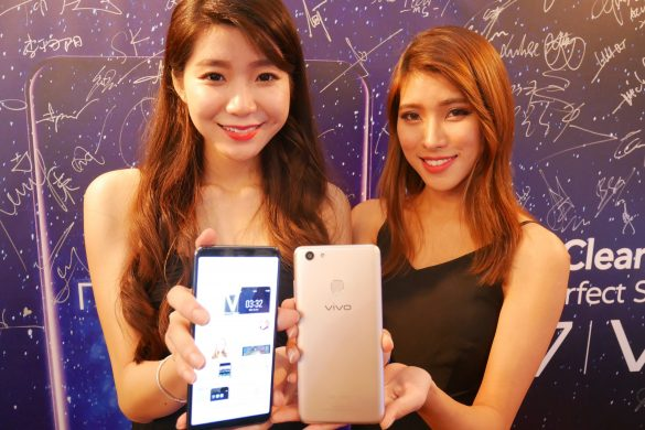 Two girls are happy with their Vivo V7+ smartphone.