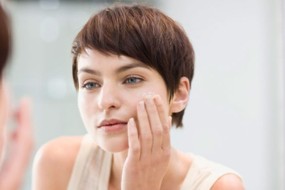 landscape-1456853261-woman-cleanses-her-face-in-mirror